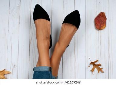 Autumn accessories, female feet and fashion shoes