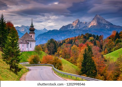 Autumn in Alps. Image of the Bavarian Alps with Maria Gern Church and Watzmann mountain during beautiful autumn sunrise.