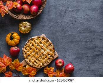 Autumn apple pie. Traditional american apple pie with fresh apples and cinnamon. Top view, copy space. Classic autumn Thanksgiving pastry dessert