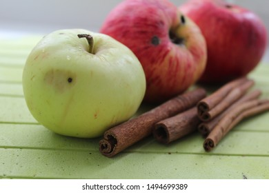 Autumn apples and cinnamon pods.