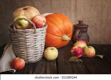 Autumn apples and pumpkins on wooden table