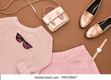 Autumn Arrives. Fashion Lady Clothes Set. Trendy Cozy Jumper. Stylish Gold Handbag Clutch, Glamour Sunglasses. Flat lay. Fall Leaves. Vanilla Pastel colors.
