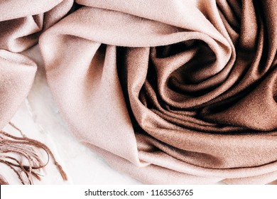 Autumn background. Beautiful elegant brown scarf. Flat lay, top view