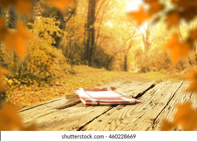 autumn background of blurred leaves on wooden space