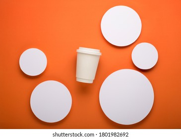 Autumn background for branding and product presentation. Paper cup of coffee on orange table. Take away coffee branding mockup. Autumn holiday concept.