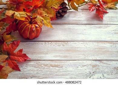 Autumn background with colored leaves on white wooden board - Shutterstock ID 488082472
