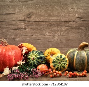 Autumn background with Fall dry decorations on wood. Side view, toned image, focus on the decorations and background. Space for your text