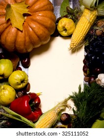 Autumn background of fruits and vegetables on the old board with empty space for text