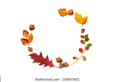 Autumn background with natural decor. Wreath made of autumn dried leaves. Flat lay, top view. Copy space for seasonal promotions and discounts. Fall, thanksgiving day concept