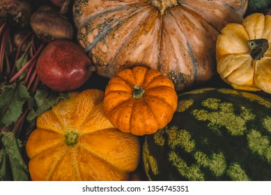 Autumn background with pumpkins, vegetables and fruit. Fall harvest. Mockup for seasonal offers. Top view.