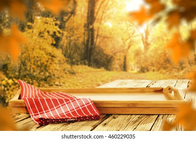 autumn background of tray of wood and napkin place