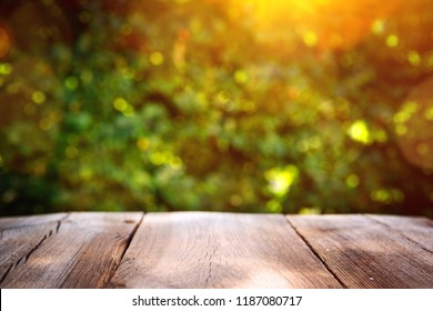 autumn background wooden board before green leave background