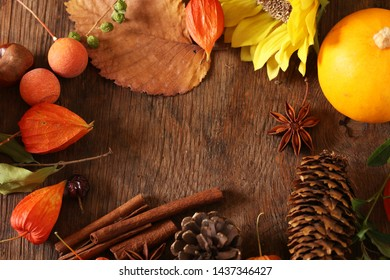 autumn background with yellow leaves of pumpkins and cones