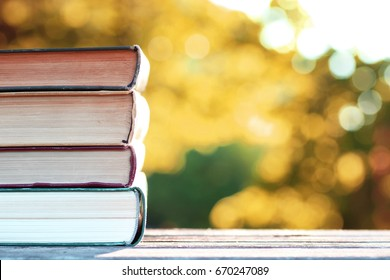 autumn book stack wooden outdoor