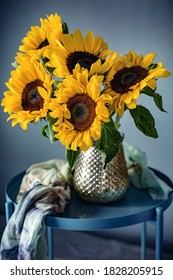 Autumn bouquet of flowers with sunflowers. Soft focus.