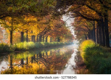 Autumn at the Canal of Apeldoorn in the Netherlands The trees reflect perfect in the water