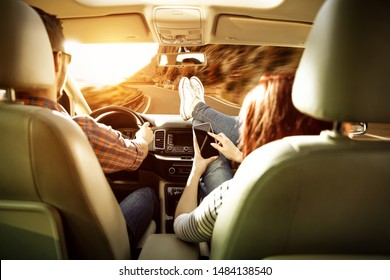 Autumn car trip and two young people. Free space for your decoration and sunset time.