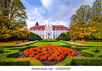 Autumn castle garden landscape. Castle garden in autumn park. Autumn castle garden scene