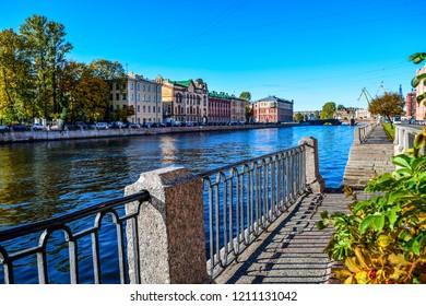 Autumn city river embankment landscape. Fontanka river embankment in autumn Saint Petersburg city, Russia. Autumn Fontanka river embankment panorama view. Autumn at city river in Russia