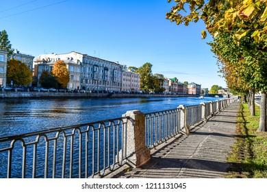 Autumn city river embankment view. Fontanka river embankment in autumn Saint Petersburg city, Russia. Autumn Fontanka river embankment in Saint Petersburg, Russia. Autumn in city view