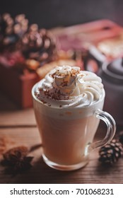 Autumn coffee with milk and cream on a wooden background