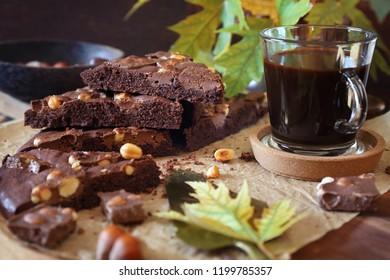 Autumn coffee pause. Kladdkaka, Swedish chocolate cake and cup of coffee