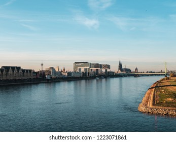 Autumn in Cologne: Cityscape of Cologne, Germany with Cathedral and other landmarks - Poller Wiesen in foreground