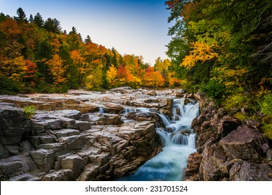 Autumn color and waterfall at Rocky Gorge, on the Kancamagus Highway, in White Mountain National Forest, New Hampshire.