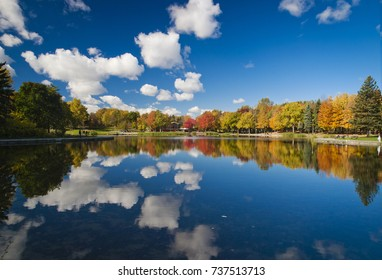 Autumn colorful reflections on the Beaver lake, in Mont Royal, Montreal, Quebec province, Canada