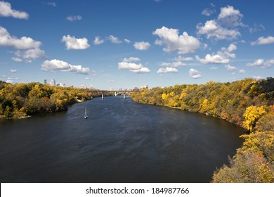 Autumn colors along the Mississippi River, Minneapolis skyline in the distance. Minnesota