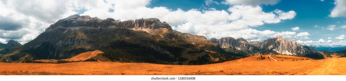 autumn colors and landscape of italian mountains in the Dolomites seen from highland of Pralongia, Trentino-Alto Adige, Italy