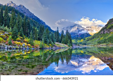 Autumn colors at Maroon Bells and with reflection in lake.