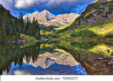 Autumn colors at Maroon Bells, with reflection in lake.