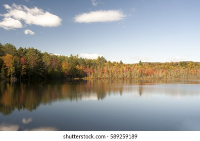 Autumn colors on a small lake in northern Maine, USA