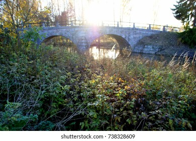Autumn colors in a sunny bridge. Autumn nature and trees. Sunny cool day. Finland.