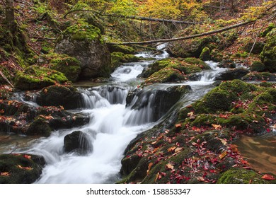 Autumn colors of a waterfall in Transylvania
