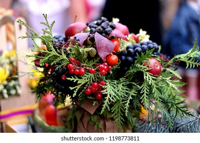 Autumn composition of berries, juniper twigs and leaves