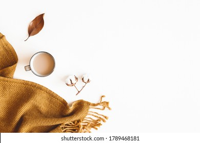 Autumn composition. Cotton flowers, plaid, cup of coffee on white background. Autumn, fall concept. Flat lay, top view