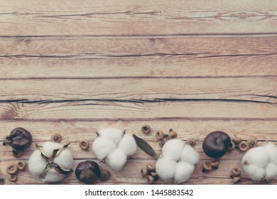Autumn composition. Dried white fluffy cotton flower top view on white wood with copy space. Floral composition