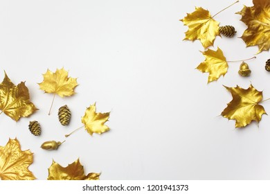 Autumn composition. Frame made of autumn golden leaves on light grey background. Flat lay, top view, copy space