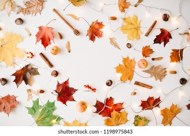 Autumn composition. Frame made of autumn leaves on white background. Flat lay, top view, copy space. Autumn, fall concept.