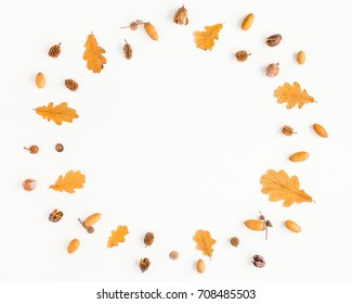 Autumn composition. Frame made of autumn oak tree leaves and pine cones on white background. Flat lay, top view, copy space