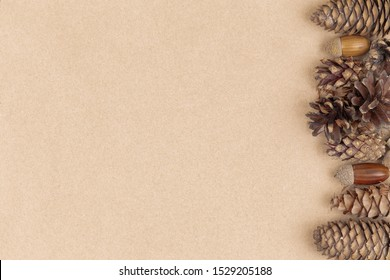 Autumn composition, frame made of pine cones, acorns and chestnuts. Flat lay, top view
