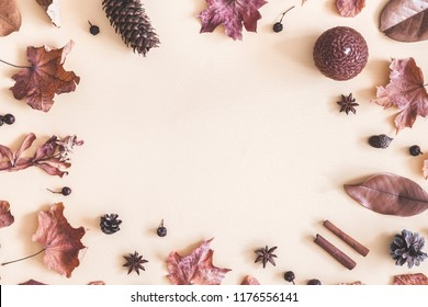 Autumn composition. Frame made of autumn things on pastel beige background. Flat lay, top view, copy space