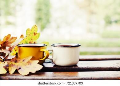 Autumn composition with hot tea