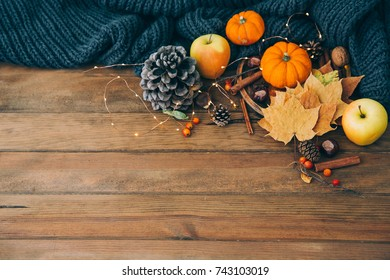Autumn composition over wooden background. Apples, pumpkin and leaves. Copy space