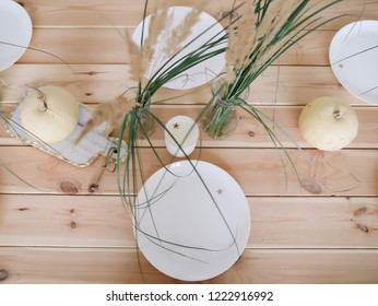 Autumn composition. Pumpkins, candles and dried flowers. Autumn, fall, halloween concept. Flat lay, top view