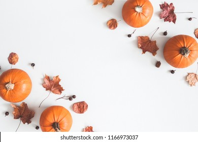 Autumn composition. Pumpkins, dried leaves on pastel gray background. Autumn, fall, halloween concept. Flat lay, top view, copy space