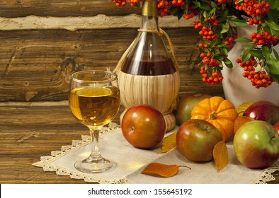 Autumn composition with white wine, apples and pumpkin.