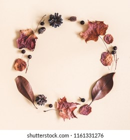 Autumn composition. Wreath made of dried leaves on pastel beige background. Autumn, fall concept. Flat lay, top view, copy space, square